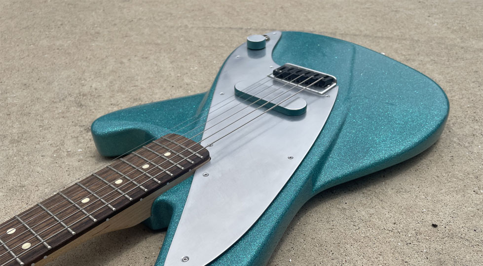 photograph of a green electric guitar